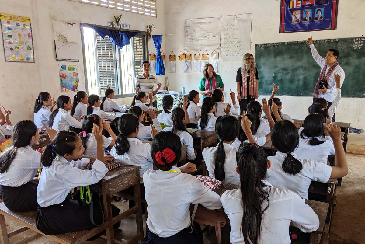 Professor Barthel and team teach in a crowded cambodian primary school.