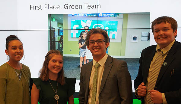 The winning Green Team from the compentition pose for a photo.