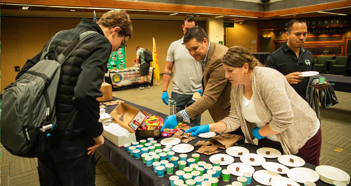 Students sampling MRE meals during Veterans Week at UVU
