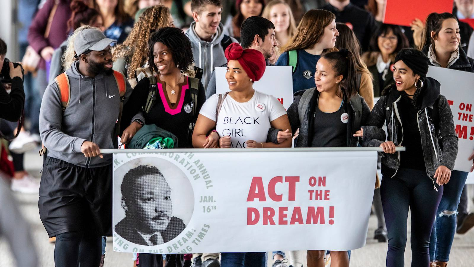 Students walk with banner commemoration Martin Luther King, Jr.