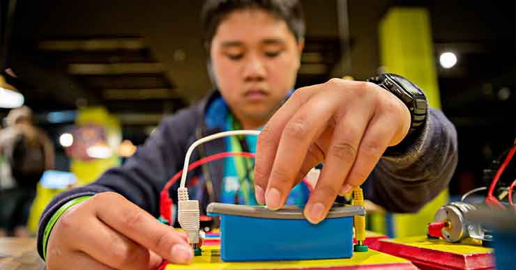 A student working on an electrical system