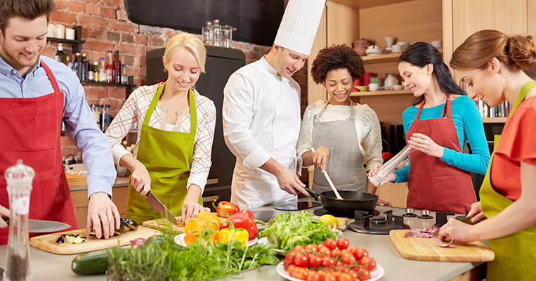 Group of people training with professional chef