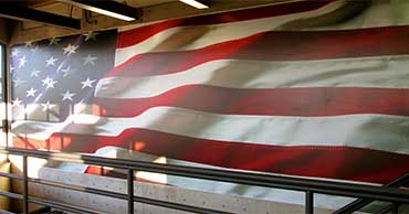 A waiving flag on a prominent wall in the Valley View Room