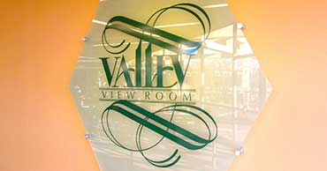 Glass signage that says Valley View Room