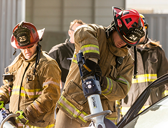 Fire chiefs working the jaws of life